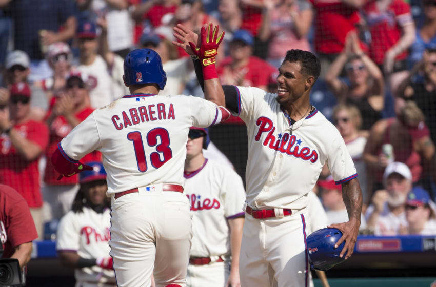 PHILADELPHIA, PA - AUGUST 5: Asdrubal Cabrera #13 of the Philadelphia Phillies celebrates with Nick Williams #5 after hitting a two run home run in the bottom of the eighth inning against the Miami Marlins at Citizens Bank Park on August 5, 2018 in Philadelphia, Pennsylvania. The Phillies defeated the Marlins 5-3. (Photo by Mitchell Leff/Getty Images)