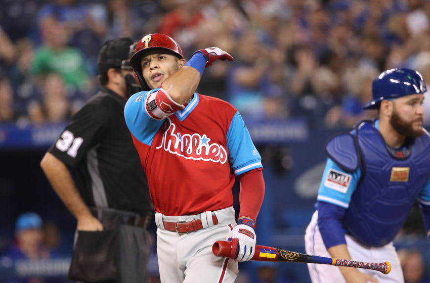 TORONTO, ON - AUGUST 24: Cesar Hernandez #16 of the Philadelphia Phillies reacts after striking out in the ninth inning during MLB game action against the Toronto Blue Jays at Rogers Centre on August 24, 2018 in Toronto, Canada. Players are wearing special jerseys with their nicknames on them during Players' Weekend. (Photo by Tom Szczerbowski/Getty Images)