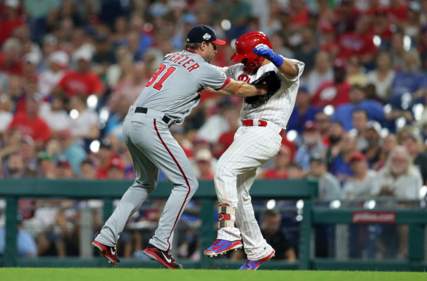 PHILADELPHIA, PA - AUGUST 28: Starting pitcher Max Scherzer #31 of the Washington Nationals tags out Jorge Alfaro #38 of the Philadelphia Phillies in the second inning during a game at Citizens Bank Park on August 28, 2018 in Philadelphia, Pennsylvania. (Photo by Hunter Martin/Getty Images)