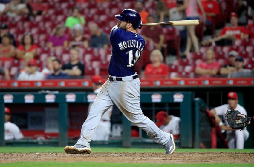 CINCINNATI, OH - AUGUST 29: Mike Moustakas #18 of the Milwaukee Brewers hits a home run in the 8th inning against the Cincinnati Reds at Great American Ball Park on August 29, 2018 in Cincinnati, Ohio. (Photo by Andy Lyons/Getty Images)