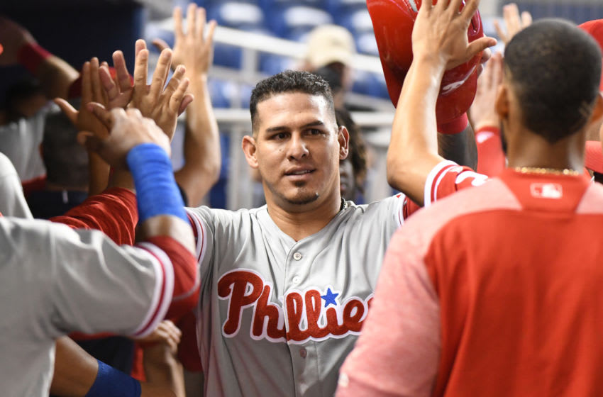 MIAMI, FL - SEPTEMBER 4: Wilson Ramos #40 of the Philadelphia Phillies is congratulated by teammates after scoring in the first inning against the Miami Marlins at Marlins Park on September 4, 2018 in Miami, Florida. (Photo by Eric Espada/Getty Images)