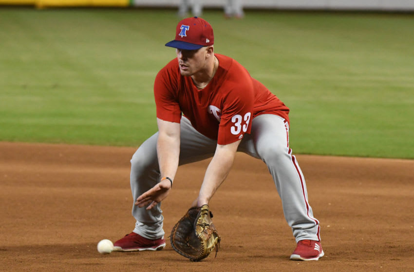 MIAMI, FL - SEPTEMBER 5: Justin Bour #33 of the Philadelphia Phillies fields a ground ball during batting practice before the start of the game against the Miami Marlins at Marlins Park on September 5, 2018 in Miami, Florida. (Photo by Eric Espada/Getty Images)