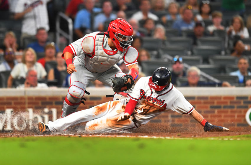 ATLANTA, GA - SEPTEMBER 21: Dansby Swanson #7 of the Atlanta Braves is tagged out a home during the seventh inning by Wilson Ramos #40 of the Philadelphia Phillies at SunTrust Park on September 21, 2018 in Atlanta, Georgia. (Photo by Scott Cunningham/Getty Images)