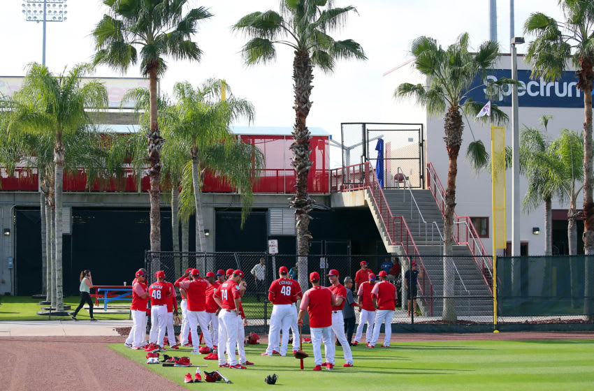 CLEARWATER, FL - FEBRUARY 16: The Phillies pitchers gather together and catch up with one with the palm trees in the background moments before the start of the Philadelphia Phillies spring training workout on February 16, 2019 at the Carpenter Complex in Clearwater, Florida. (Photo by Cliff Welch/Icon Sportswire via Getty Images)