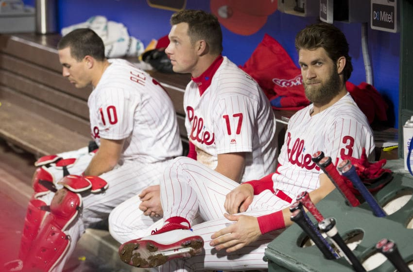 J.T. Realmuto #10, Rhys Hoskins #17, and Bryce Harper #3 of the Philadelphia Phillies (Photo by Mitchell Leff/Getty Images)