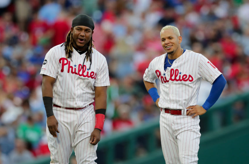 PHILADELPHIA, PA - JULY 12: Maikel Franco #7 and Cesar Hernandez #16 of the Philadelphia Phillies smile during a game against the Washington Nationals at Citizens Bank Park on July 12, 2019 in Philadelphia, Pennsylvania. The Nationals won 4-0. (Photo by Hunter Martin/Getty Images)