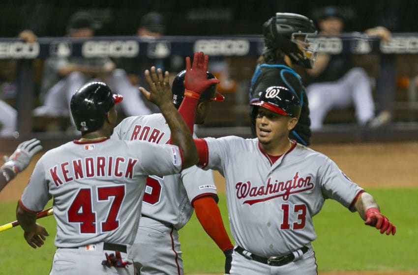 The Washington Nationals' Asdrubal Cabrera (13) celebrates with teammate Howie Kendrick (47) after hitting a three-run home run against the Miami Marlins in the fourth inning at Marlins Park in Miami on Friday, Sept. 20, 2019. The Nationals won, 6-4. (Matias J. Ocner/Miami Herald/Tribune News Service via Getty Images)