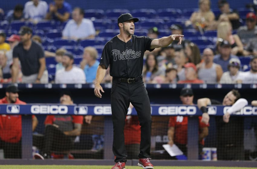 MIAMI, FLORIDA - AUGUST 25: Manager Gabe Kapler #19 of the Philadelphia Phillies reacts against the Miami Marlins at Marlins Park on August 25, 2019 in Miami, Florida. Teams are wearing special color schemed uniforms with players choosing nicknames to display for Players' Weekend. (Photo by Michael Reaves/Getty Images)