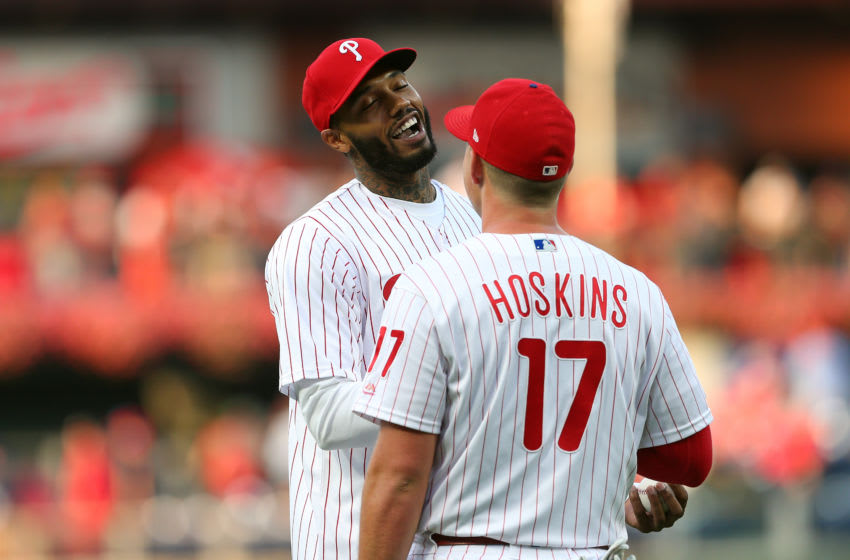 PHILADELPHIA, PA - SEPTEMBER 28: Mike Scott of the Philadelphia 76ers shakes hands with Rhys Hoskins #17 of the Philadelphia Phillies after he threw out the first pitch before a game between the Miami Marlins and Philadelphia Phillies at Citizens Bank Park on September 28, 2019 in Philadelphia, Pennsylvania. The Phillies defeated the Marlins 9-3. (Photo by Rich Schultz/Getty Images)