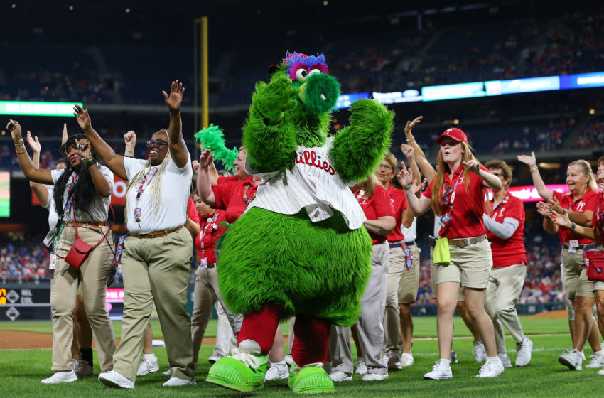 PHILADELPHIA, PA - SEPTEMBER 28: The Phillie Phanatic performs with employees of the Philadelphia Phillies during a game against the Miami Marlins at Citizens Bank Park on September 28, 2019 in Philadelphia, Pennsylvania. (Photo by Rich Schultz/Getty Images)