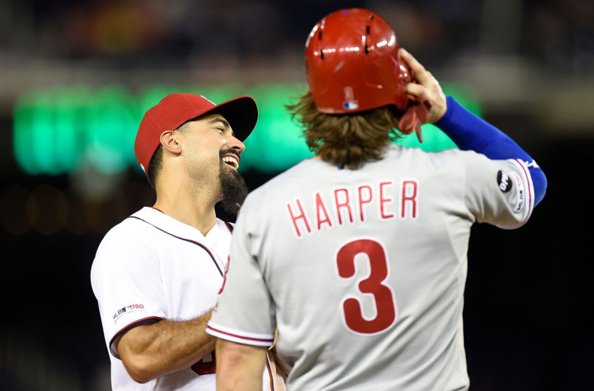 WASHINGTON, DC - SEPTEMBER 23: Anthony Rendon #6 of the Washington Nationals talks with Bryce Harper #3 of the Philadelphia Phillies during the sixth inning at Nationals Park on September 23, 2019 in Washington, DC. (Photo by G Fiume/Getty Images)