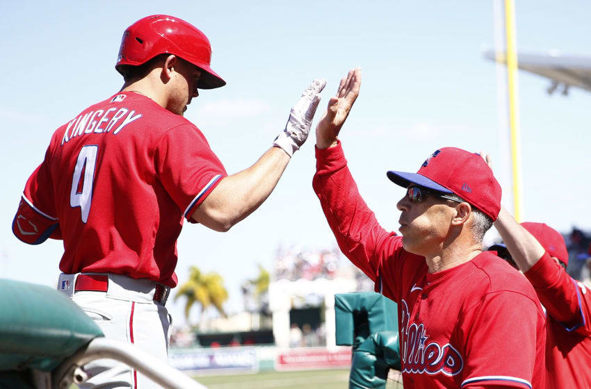Scott Kingery #4 of the Philadelphia Phillies high fives manager Joe Girardi (Photo by Michael Reaves/Getty Images)
