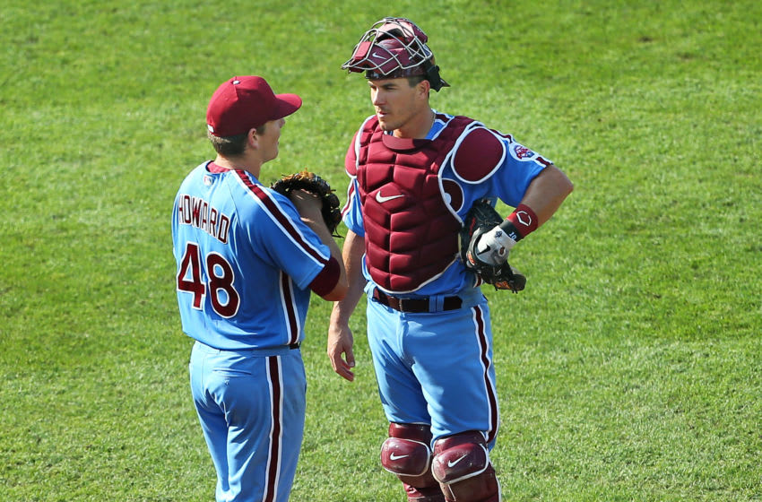 Pitcher Spencer Howard #48 of the Philadelphia Phillies talks with catcher J.T. Realmuto #10 (Photo by Rich Schultz/Getty Images)