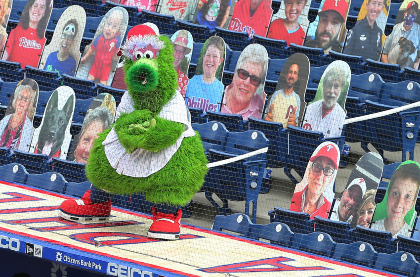 The Phillie Phanatic entertains amongst the cardboard cutout fans (Photo by Rich Schultz/Getty Images)