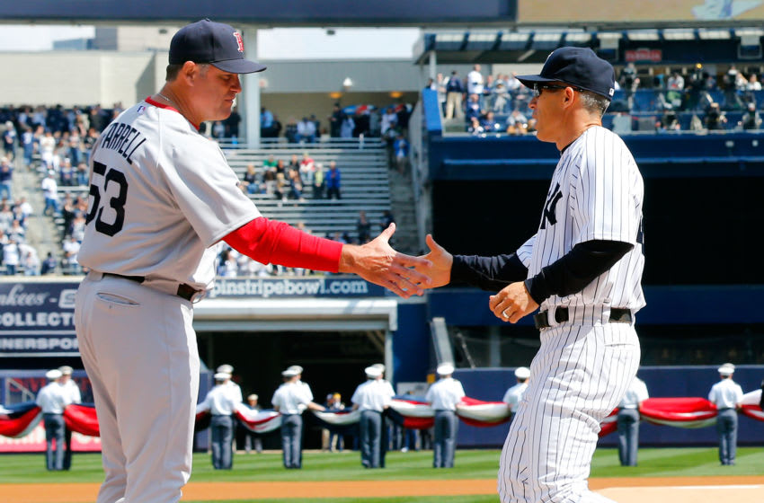 NEW YORK, NY - APRIL 01: (NEW YORK DAILIES OUT) Managers John Farrell #53 of the Boston Red Sox and Joe Girardi #28 of the New York Yankees shake hands during Opening Day ceremonies at Yankee Stadium on April 1, 2013 in the Bronx borough of New York City. The Red Sox defeated the Yankees 8-2. (Photo by Jim McIsaac/Getty Images)