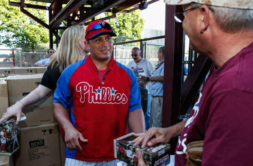 PHILADELPHIA, PA - JUNE 04: Carlos Ruiz #51 of the Philadelphia Phillies give a fan a bobble head at the entrance to the park before the game against the Miami Marlins at Citizens Bank Park on June 4, 2013 in Philadelphia, Pennsylvania. (Photo by Brian Garfinkel/Getty Images)