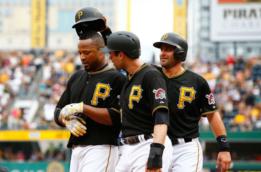 PITTSBURGH, PA - AUGUST 08: Francisco Liriano #47 of the Pittsburgh Pirates is congratulated by teammates Neil Walker #18 and Francisco Cervelli #29 after hitting a three run home run in the third inning against the Los Angles Dodgers during the game at PNC Park on August 8, 2015 in Pittsburgh, Pennsylvania. (Photo by Jared Wickerham/Getty Images)