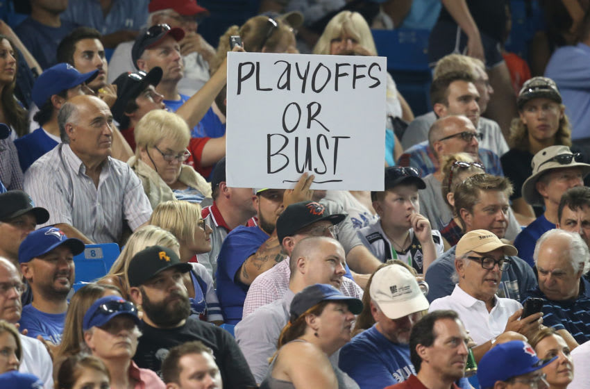 TORONTO, CANADA - JULY 28: A Toronto Blue Jays fan holds a sign about the teamâs drive to the playoffs during MLB game action against the Philadelphia Phillies on July 28, 2015 at Rogers Centre in Toronto, Ontario, Canada. (Photo by Tom Szczerbowski/Getty Images)