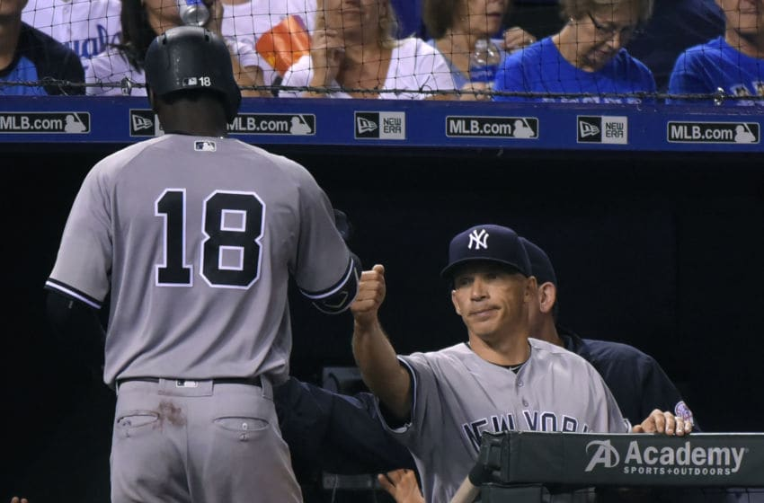 KANSAS CITY, MO - AUGUST 31: Didi Gregorius #18 of the New York Yankees is congratulated by manager Joe Girardi #28 after hitting a sacrifice fly in the sixth inning against the Kansas City Royals at Kauffman Stadium on August 31, 2016 in Kansas City, Missouri. (Photo by Ed Zurga/Getty Images)