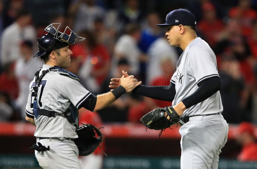 ANAHEIM, CA - JUNE 12: Austin Romine #27 shakes hands with Dellin Betances #68 of the New York Yankees after defeating the Los Angeles Angels of Anaheim 5-3 during a game at Angel Stadium of Anaheim on June 12, 2017 in Anaheim, California. (Photo by Sean M. Haffey/Getty Images)