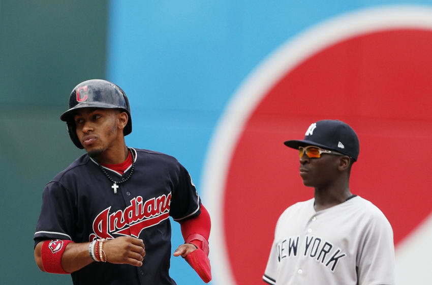 CLEVELAND, OH - AUGUST 06: Francisco Lindor #12 of the Cleveland Indians advances to second base on a wild pitch against the New York Yankees in the fourth inning as Didi Gregorius #18 looks on at Progressive Field on August 6, 2017 in Cleveland, Ohio. The Yankees defeated the Indians 8-1. (Photo by David Maxwell/Getty Images)
