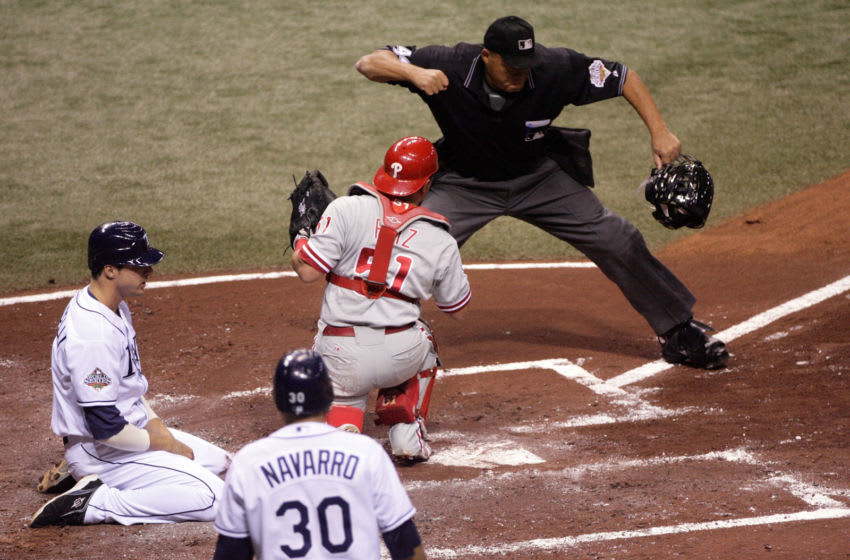 Home plate umpire Kerwin Danley #44 calls out Rocco Baldelli #5 of the Tampa Bay Rays (Photo by Doug Pensinger/Getty Images)
