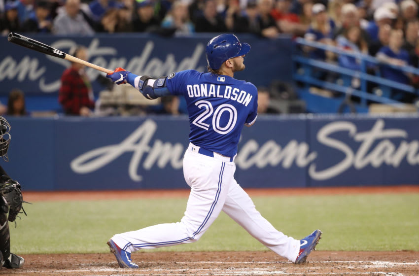 TORONTO, ON - APRIL 3: Josh Donaldson #20 of the Toronto Blue Jays hits a two-run home run in the fourth inning during MLB game action against the Chicago White Sox at Rogers Centre on April 3, 2018 in Toronto, Canada. (Photo by Tom Szczerbowski/Getty Images)