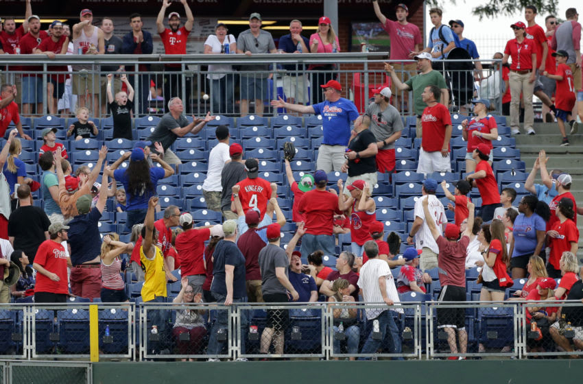 PHILADELPHIA, PA - MAY 26: A fan attempts to catch a home run ball off the bat of Nick Williams of the Philadelphia Phillies in the eighth inning during a game against the Toronto Blue Jays at Citizens Bank Park on May 26, 2018 in Philadelphia, Pennsylvania. The Phillies won 2-1. (Photo by Hunter Martin/Getty Images)
