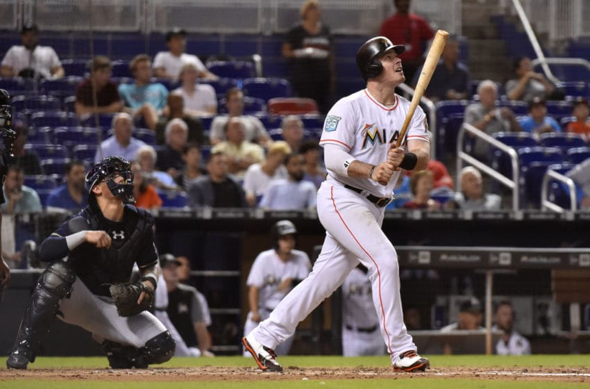 MIAMI, FL - JULY 11: Justin Bour #41 of the Miami Marlins hits a home run in the fourth inning against the Milwaukee Brewers at Marlins Park on July 11, 2018 in Miami, Florida. (Photo by Eric Espada/Getty Images)