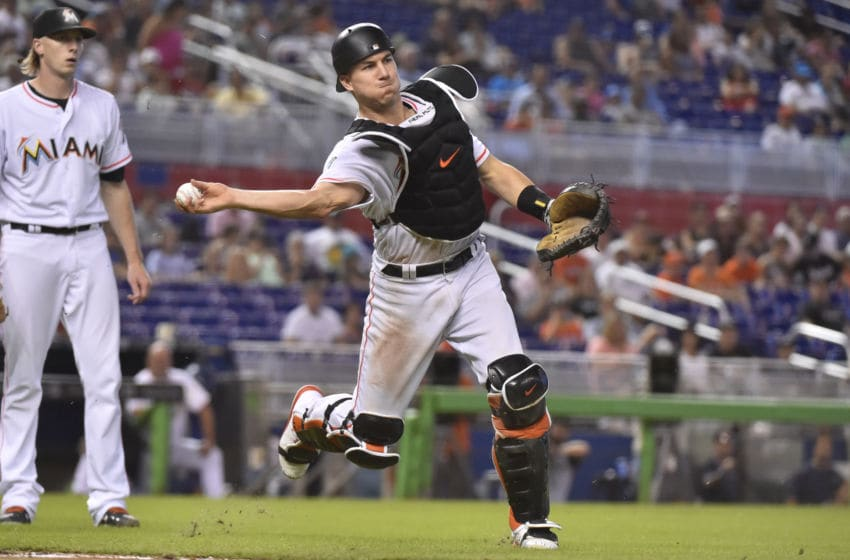 MIAMI, FL - JULY 15: J.T. Realmuto #11 of the Miami Marlins throws towards first base during the eighth inning against the Philadelphia Phillies at Marlins Park on July 15, 2018 in Miami, Florida. (Photo by Eric Espada/Getty Images)