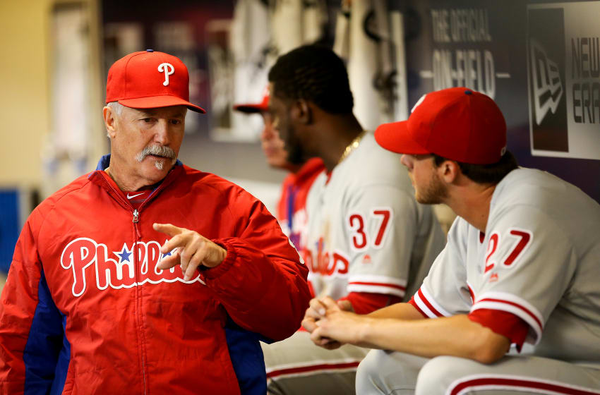 MILWAUKEE, WI - APRIL 22: Pitching coach Bob McClure talks with Aaron Nola
