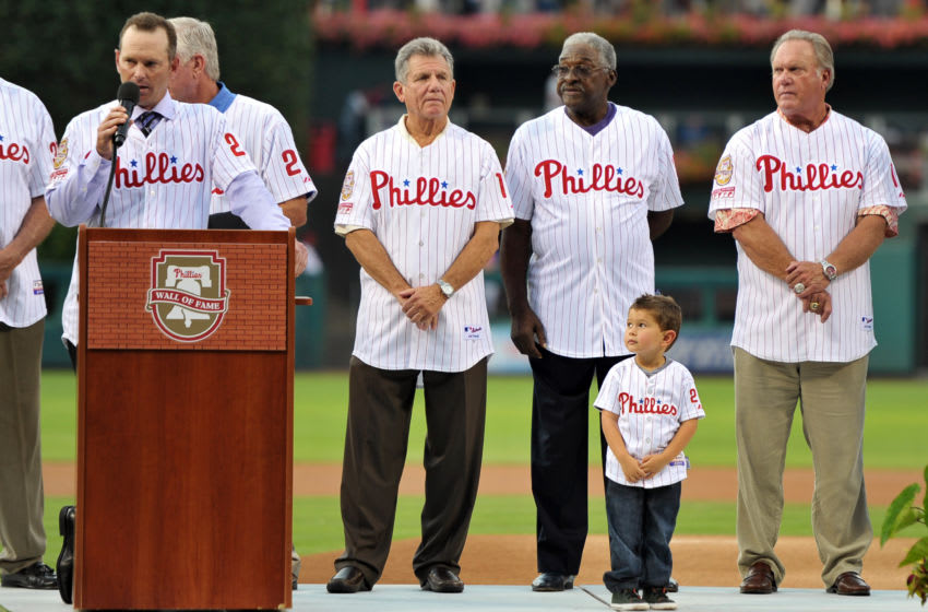 PHILADELPHIA, PA - AUGUST 10: Former Phillies catcher and Wall of Fame inductee, Mike Leiberthal addresses the crowd as he is watched by (L-R) Larry Bowa, Tony Taylor, his four year old son Merek and Greg Luzinski during ceremonies before the game against the St. Louis Cardinals at Citizens Bank Park on August 10, 2012 in Philadelphia, Pennsylvania. (Photo by Drew Hallowell/Getty Images)