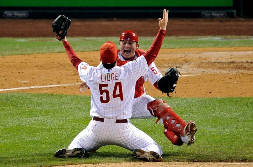 PHILADELPHIA - OCTOBER 29: Catcher Carlos Ruiz #51 and Brad Lidge #54 of the Philadelphia Phillies celebrate after recording the final out of their 4-3 win to win the World Series against the Tampa Bay Rays during the continuation of game five of the 2008 MLB World Series on October 29, 2008 at Citizens Bank Park in Philadelphia, Pennsylvania. (Photo by Jeff Zelevansky/Getty Images)