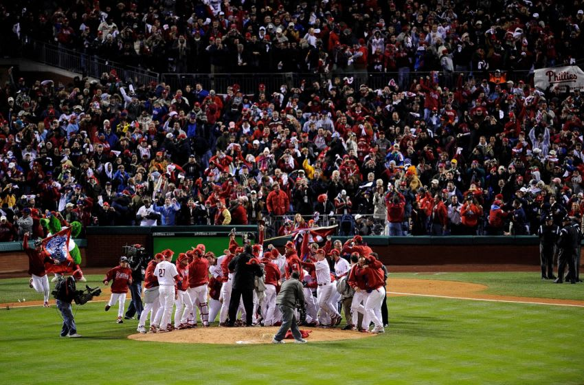 PHILADELPHIA - OCTOBER 29: The Philadelphia Phillies celebrate with their fans after they won 4-3 against the Tampa Bay Rays during the continuation of game five of the 2008 MLB World Series on October 29, 2008 at Citizens Bank Park in Philadelphia, Pennsylvania. (Photo by Jeff Zelevansky/Getty Images)