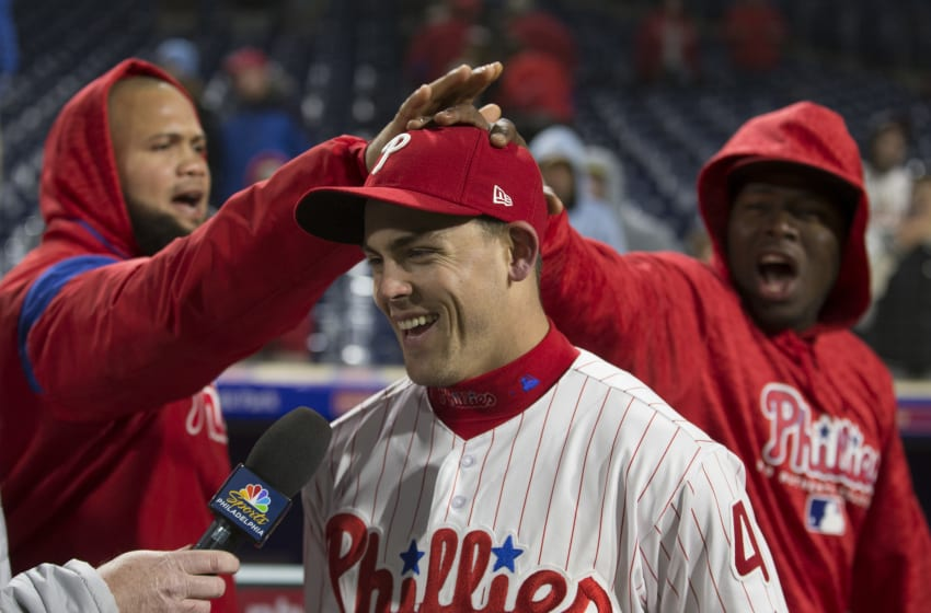 PHILADELPHIA, PA - APRIL 10: Scott Kingery #4 of the Philadelphia Phillies has his head rubbed by Luis Garcia #57 and Hector Neris #50 after the game against the Cincinnati Reds at Citizens Bank Park on April 10, 2018 in Philadelphia, Pennsylvania. The Phillies defeated the Reds 6-1. (Photo by Mitchell Leff/Getty Images)