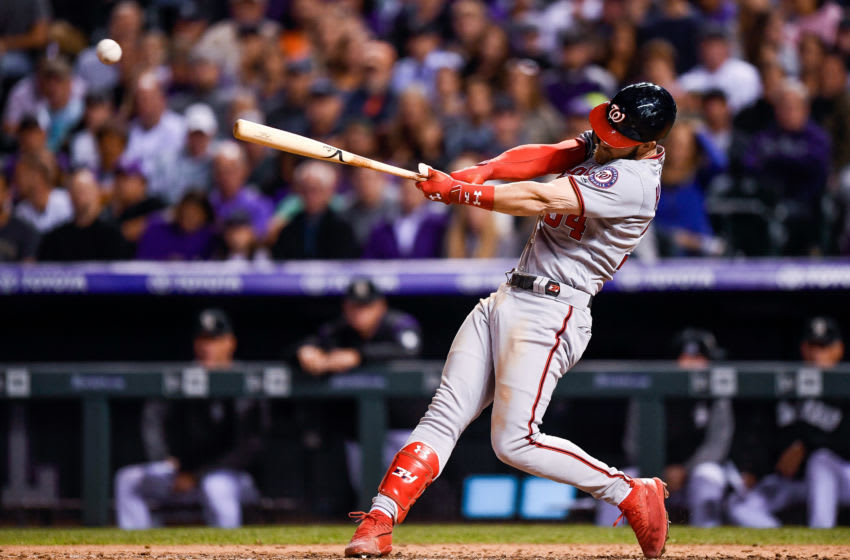 DENVER, CO - SEPTEMBER 29: Bryce Harper #34 of the Washington Nationals hits a seventh inning single against the Colorado Rockies at Coors Field on September 29, 2018 in Denver, Colorado. (Photo by Dustin Bradford/Getty Images)