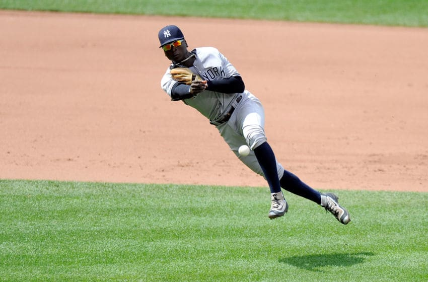 BALTIMORE, MD - JUNE 05: Didi Gregorius #18 of the New York Yankees throws the ball to first base in the fifth inning against the Baltimore Orioles at Oriole Park at Camden Yards on June 5, 2016 in Baltimore, Maryland. (Photo by Greg Fiume/Getty Images)