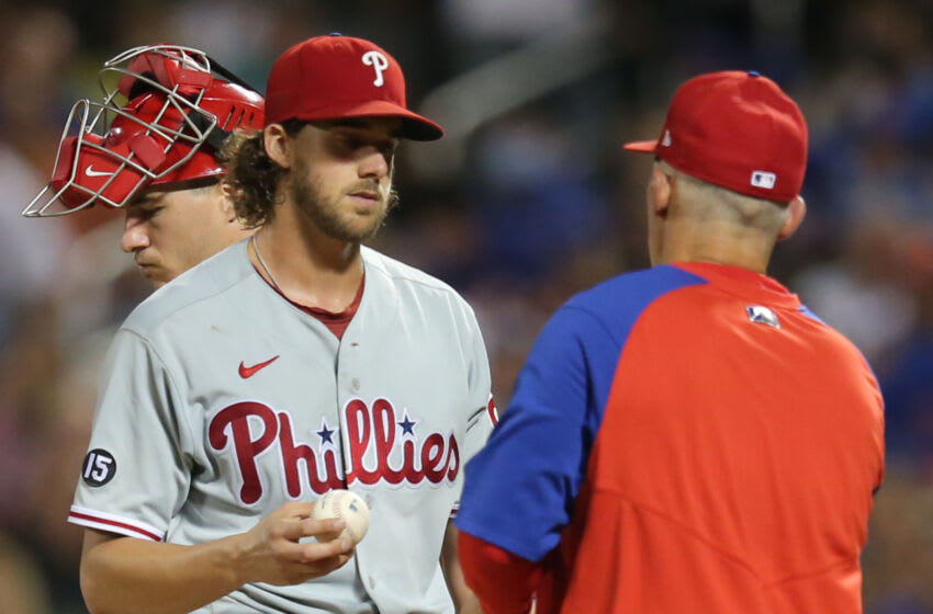 Sep 18, 2021; New York City, New York, USA; Philadelphia Phillies manager Joe Girardi (right) takes the ball from starting pitcher Aaron Nola (27) during a pitching change in the sixth inning against the New York Mets at Citi Field. Mandatory Credit: Brad Penner-USA TODAY Sports
