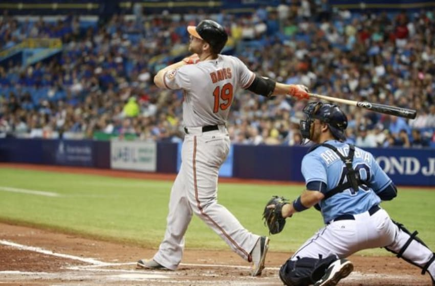 Sep 20, 2015; St. Petersburg, FL, USA; Baltimore Orioles designated hitter Chris Davis (19) hits a 2-run home run during the third inning against the Tampa Bay Rays at Tropicana Field. Mandatory Credit: Kim Klement-USA TODAY Sports