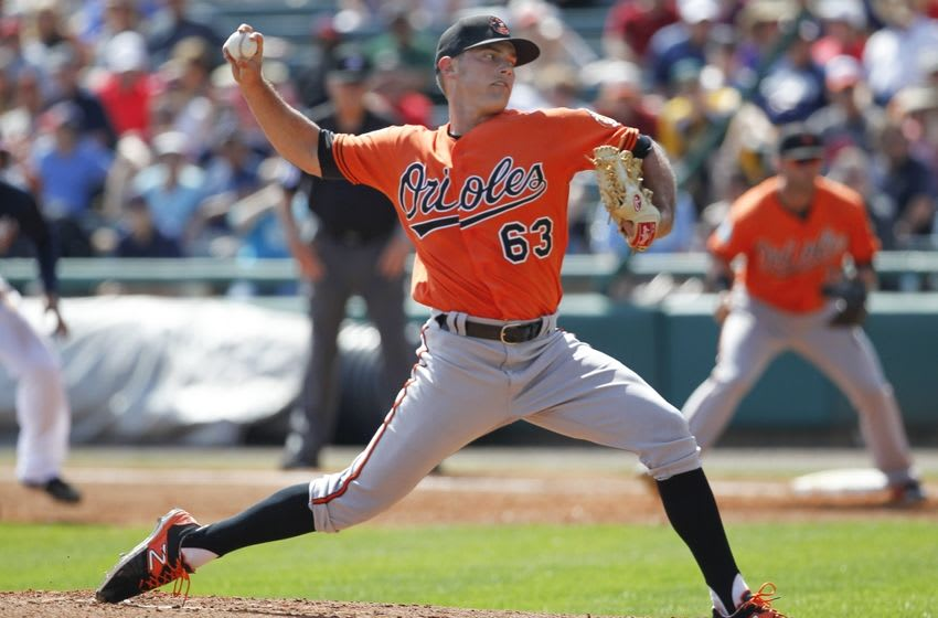 Mar 1, 2016; Lake Buena Vista, FL, USA; Baltimore Orioles relief pitcher Tyler Wilson (63) throws a pitch during the third inning of a spring training baseball game against the Atlanta Braves at Champion Stadium. Mandatory Credit: Reinhold Matay-USA TODAY Sports