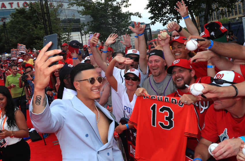 WASHINGTON, DC - JULY 17: Manny Machado #13 of the Baltimore Orioles and the American interacts with fans at the 89th MLB All-Star Game, presented by MasterCard red carpet at Nationals Park on July 17, 2018 in Washington, DC. (Photo by Mike Lawrie/Getty Images)