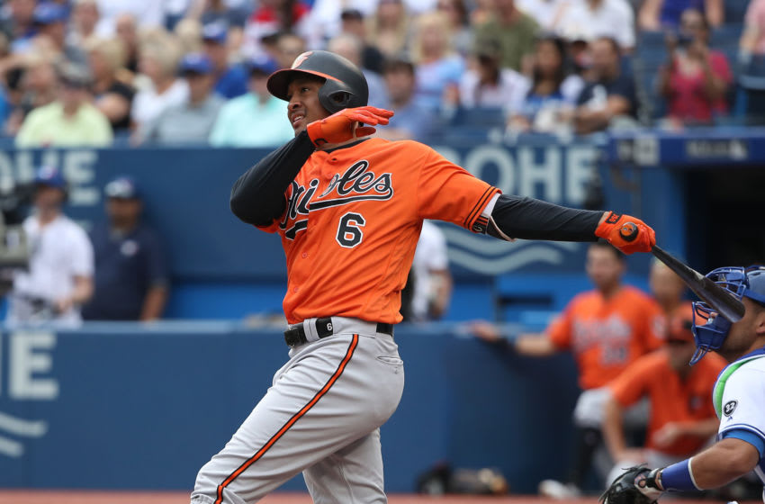 TORONTO, ON - JULY 21: Jonathan Schoop #6 of the Baltimore Orioles hits a single in the first inning during MLB game action against the Toronto Blue Jays at Rogers Centre on July 21, 2018 in Toronto, Canada. (Photo by Tom Szczerbowski/Getty Images)