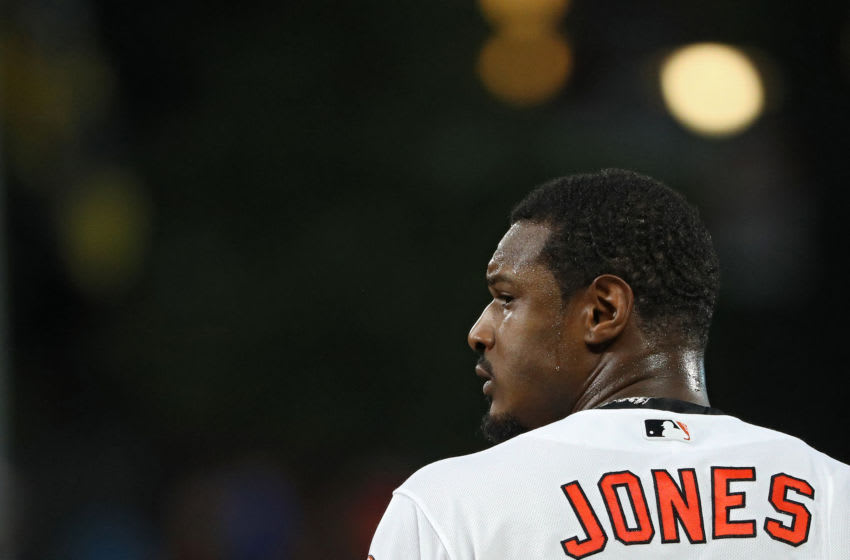 BALTIMORE, MD - JULY 25: Adam Jones #10 of the Baltimore Orioles looks on after the end of the first inning against the Boston Red Sox at Oriole Park at Camden Yards on July 25, 2018 in Baltimore, Maryland. (Photo by Patrick Smith/Getty Images)