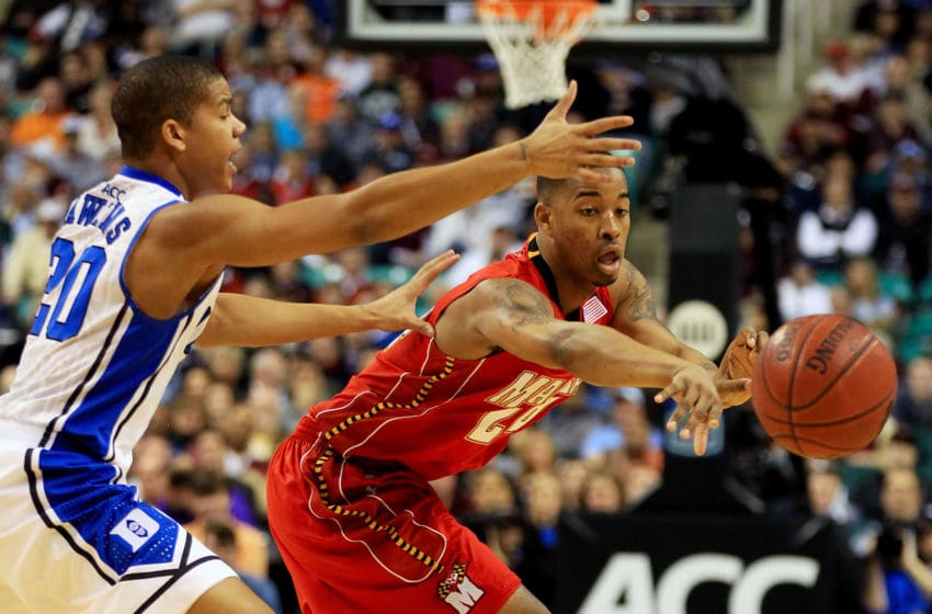 GREENSBORO, NC - MARCH 11: Cliff Tucker #24 of the Maryland Terrapins passes against Andre Dawkins #20 of the Duke Blue Devils during the first half in the quarterfinals of the 2011 ACC men's basketball tournament at the Greensboro Coliseum on March 11, 2011 in Greensboro, North Carolina. Duke won 87-71 in regulation. (Photo by Streeter Lecka/Getty Images)