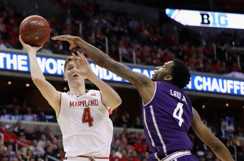 WASHINGTON, DC - MARCH 10: Kevin Huerter #4 of the Maryland Terrapins puts up a shot in front of Vic Law #4 of the Northwestern Wildcats during the Big Ten Basketball Tournament at Verizon Center on March 10, 2017 in Washington, DC. (Photo by Rob Carr/Getty Images)