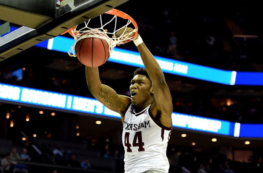 CHARLOTTE, NC - MARCH 16: Robert Williams #44 of the Texas A&M Aggies dunks on the Providence Friars during the first round of the 2018 NCAA Men's Basketball Tournament at Spectrum Center on March 16, 2018 in Charlotte, North Carolina. (Photo by Jared C. Tilton/Getty Images)