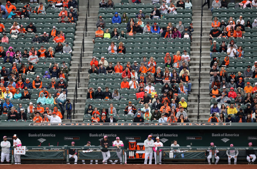BALTIMORE, MD - MAY 13: Members of the Baltimore Orioles look on from the dugout in the second inning against the Tampa Bay Rays at Oriole Park at Camden Yards on May 13, 2018 in Baltimore, Maryland. (Photo by Rob Carr/Getty Images)