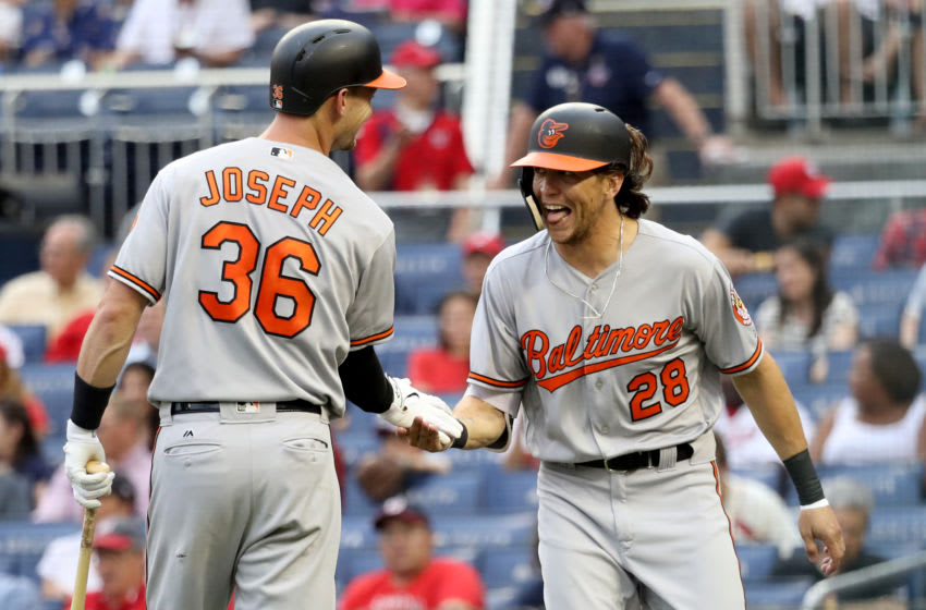 WASHINGTON, DC - JUNE 21: Colby Rasmus #28 of the Baltimore Orioles celebrates with Caleb Joseph #36 after hitting a solo home run in the second inning against the Washington Nationals at Nationals Park on June 21, 2018 in Washington, DC. (Photo by Rob Carr/Getty Images)