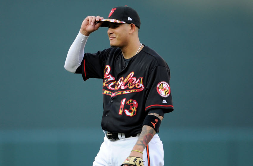 BALTIMORE, MD - JULY 14: Manny Machado #13 of the Baltimore Orioles warms up before the game against the Texas Rangers at Oriole Park at Camden Yards on July 14, 2018 in Baltimore, Maryland. (Photo by Greg Fiume/Getty Images)