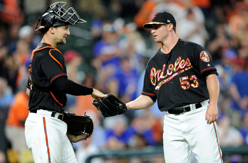 BALTIMORE, MD - JULY 14: Zach Britton #53 of the Baltimore Orioles celebrates with Caleb Joseph #36 after a 1-0 victory against the Texas Rangers at Oriole Park at Camden Yards on July 14, 2018 in Baltimore, Maryland. (Photo by Greg Fiume/Getty Images)